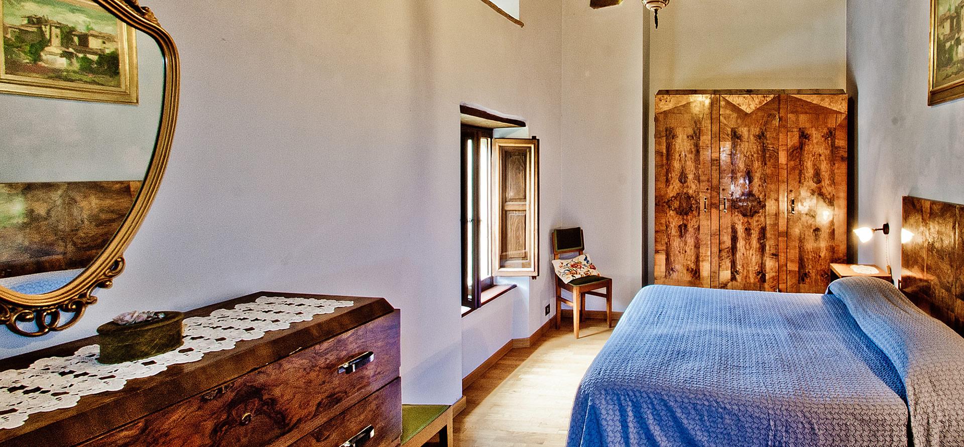 Camera blu appartamento vacanza Mirolago 6-10 persone