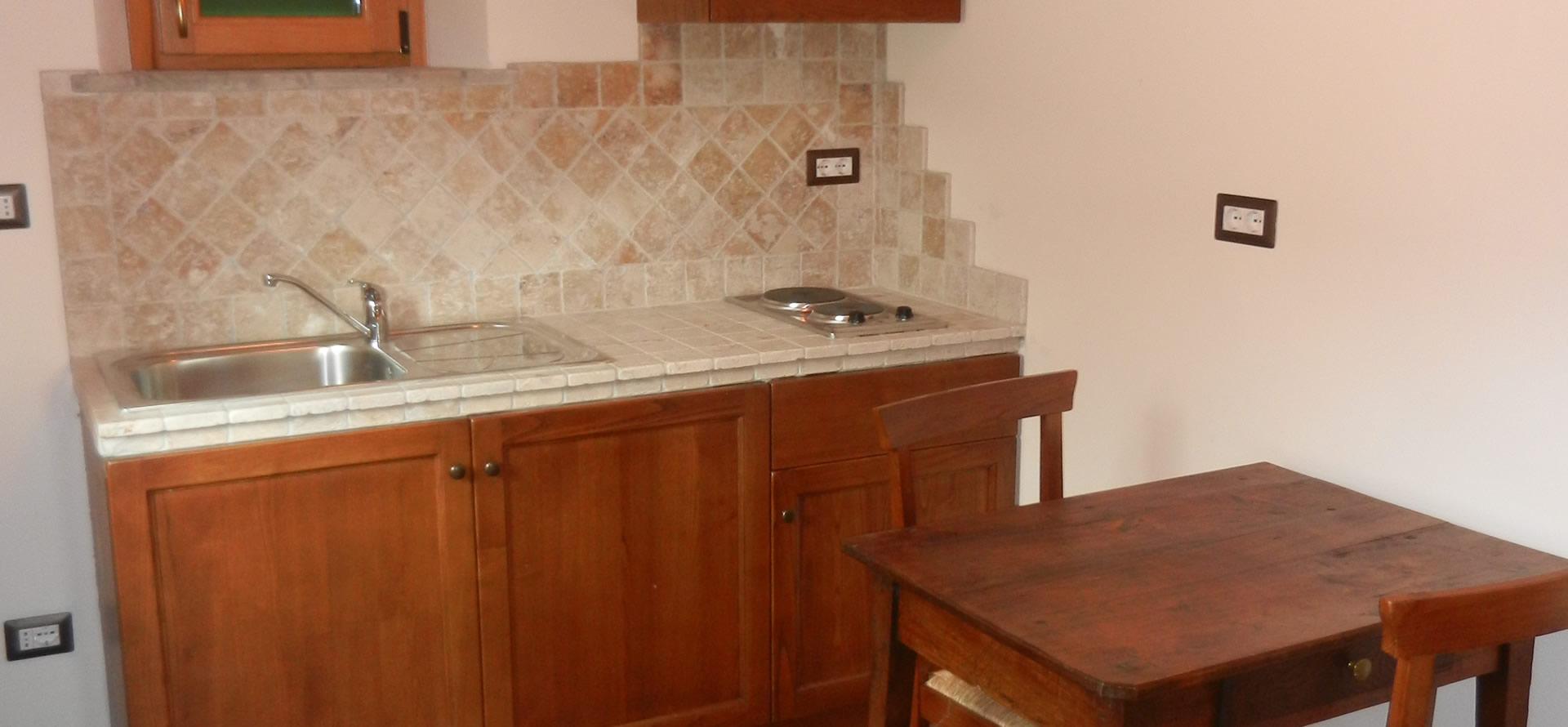 Cucina attrezzata e soggiorno Appartamento Olivo